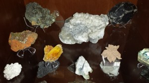 The large smoky quartz in the back right corner is from the driveway of my house in Colorado. It still has facets, but is well worn so it must have been away from its growth place for a long time. Would love to know its story!